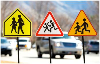 From left to right: Pedestrian warning signs for the U.S., Poland, and Russia