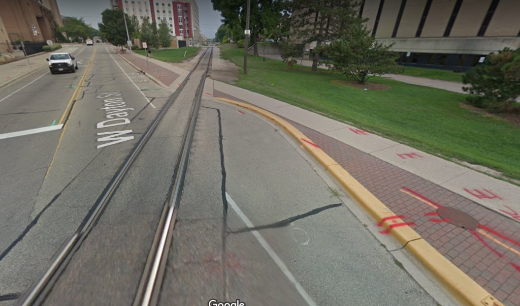 Image of bike/train track crossing in Madison, WI that is near-perpendicular